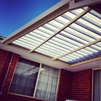 Tapered patio, clad with translucent roof sheeting