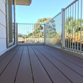 Custom steel balcony with a composite deck floor